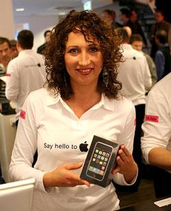Vendedora da T-Mobile com iPhone