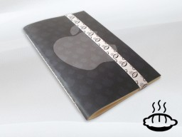 Caderno da Flaming Pie com marca da Apple