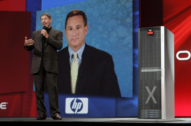 Oracle CEO Larry Ellison speaks with Hewlett-Packard CEO Mark Hurd via video in San Francisco