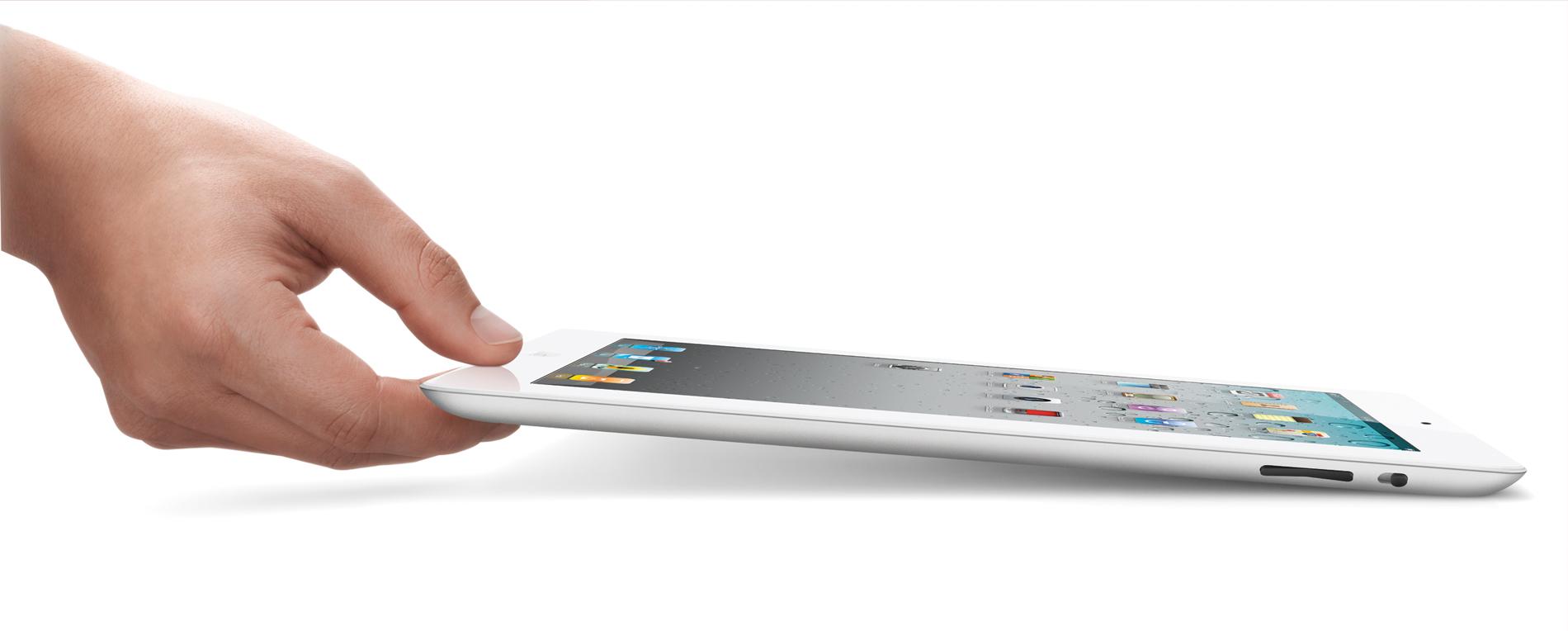 iPad 2 de lado, com mão o segurando