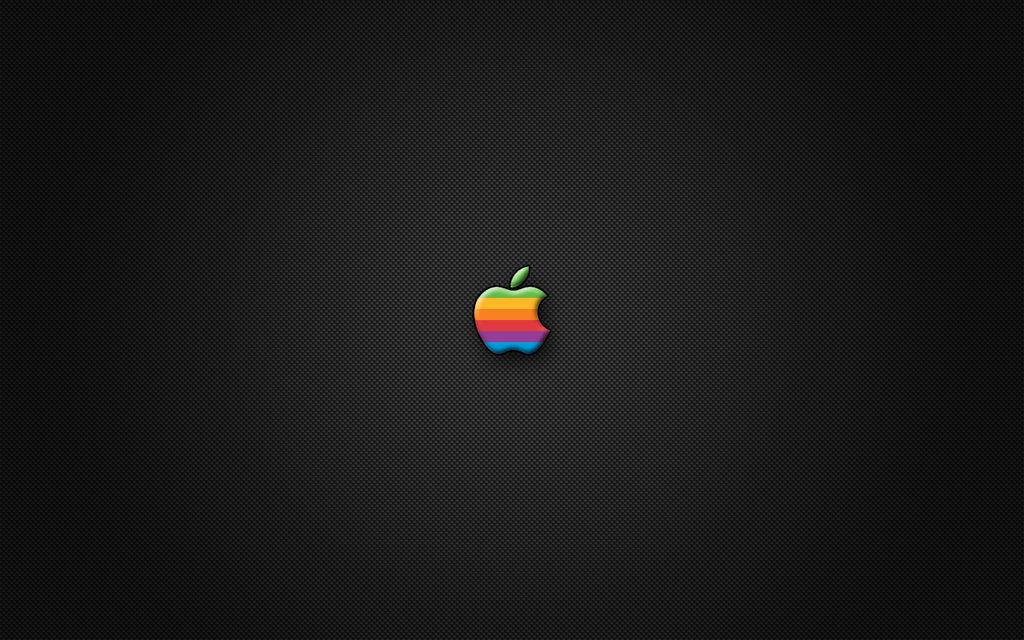 Logo da Apple em fundo de fibra de carbono