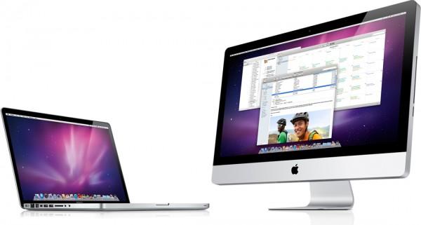 MacBook Pro ao lado de iMac