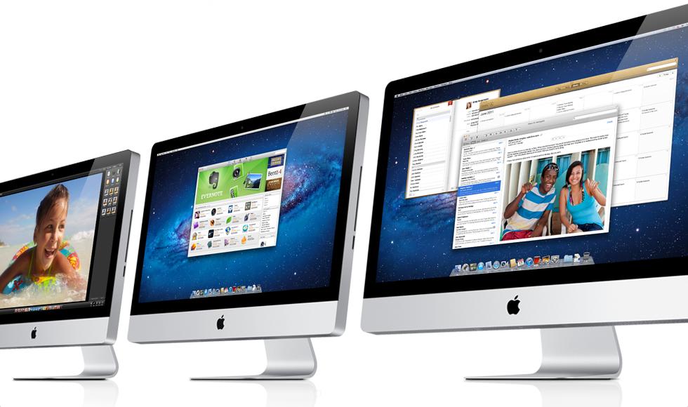 Três iMacs de lado