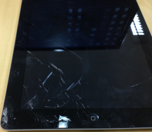 iPad quebrado de leitor