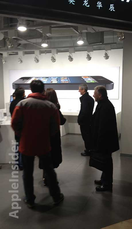 Tim Cook e Phil Schiller na China