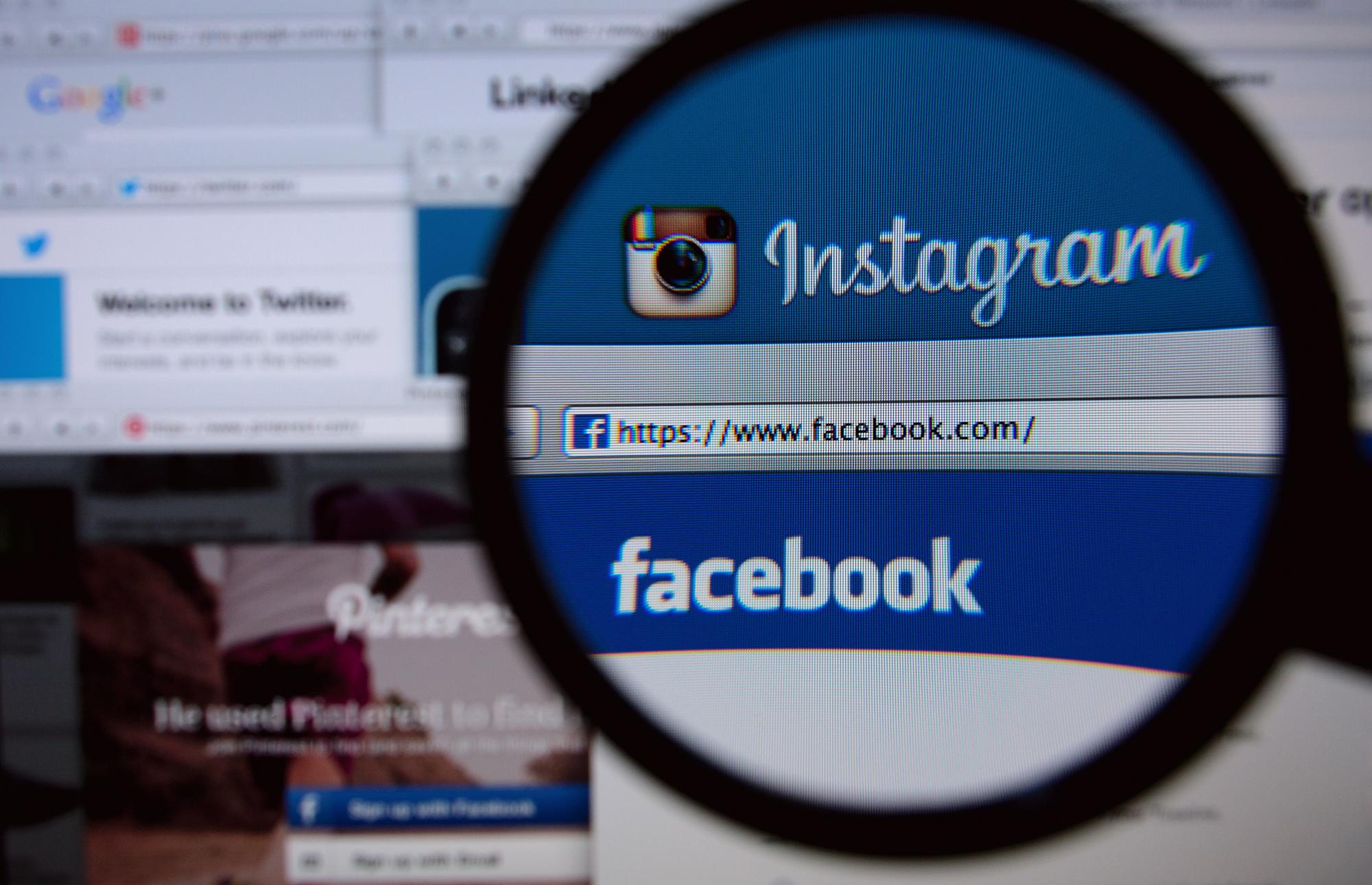 Facebook e Instagram numa lupa