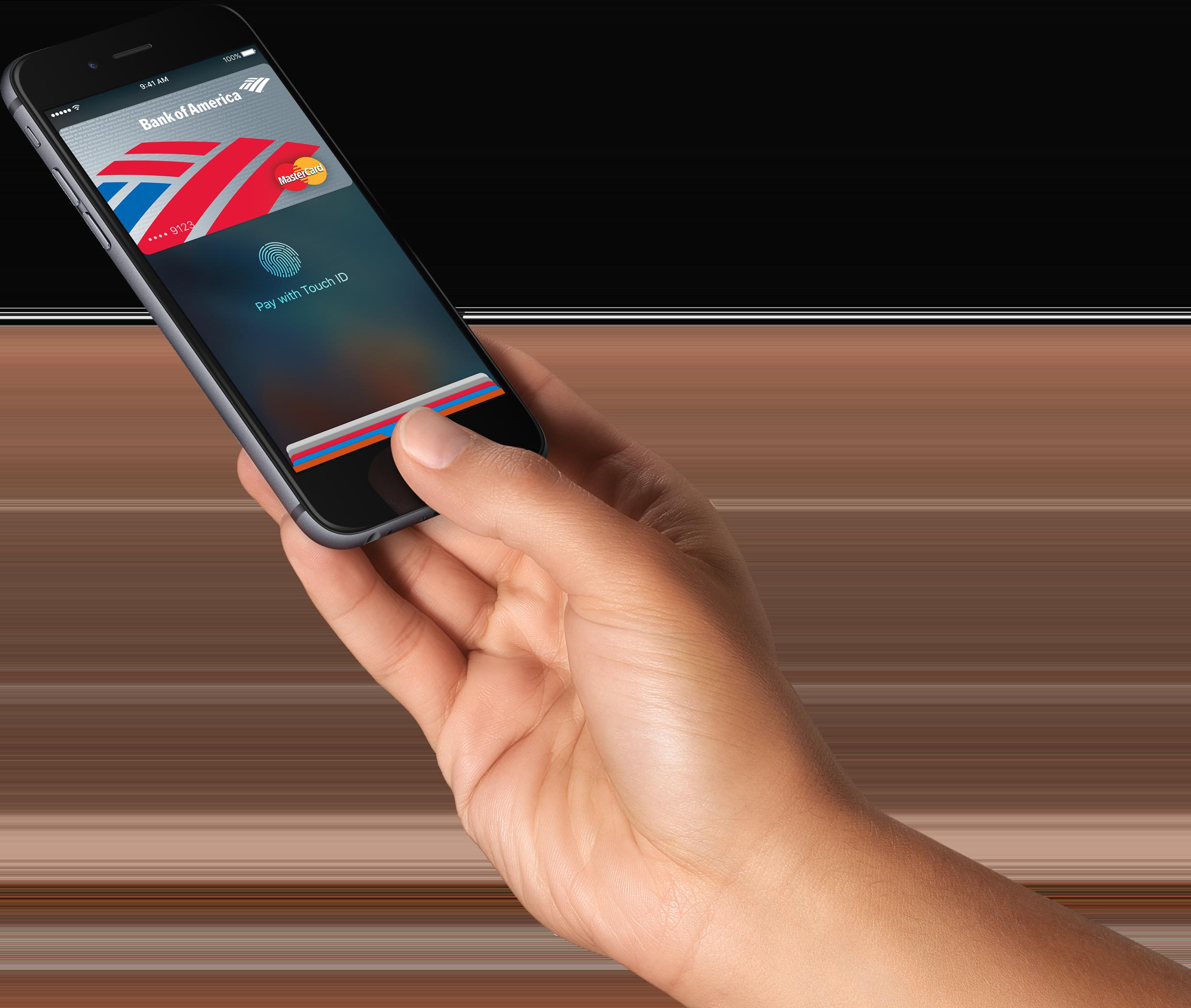 Mão segurando iPhone com o Apple Pay