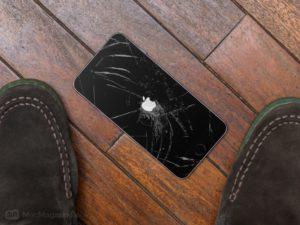 iPhone no chão, quebrado, na tela de boot/inicialização