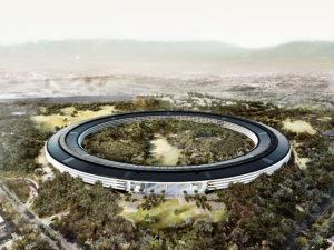 Render 3D belíssimo do Apple Park visto de cima num ângulo com muitas árvores