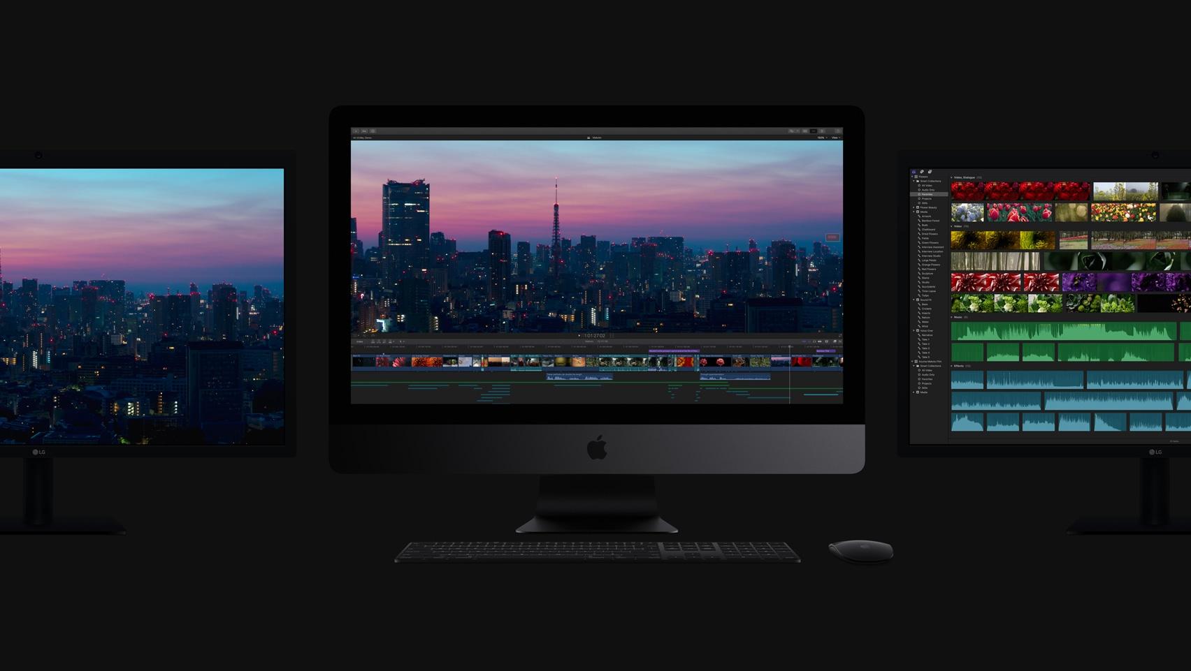 iMacs Pro de frente no escuro