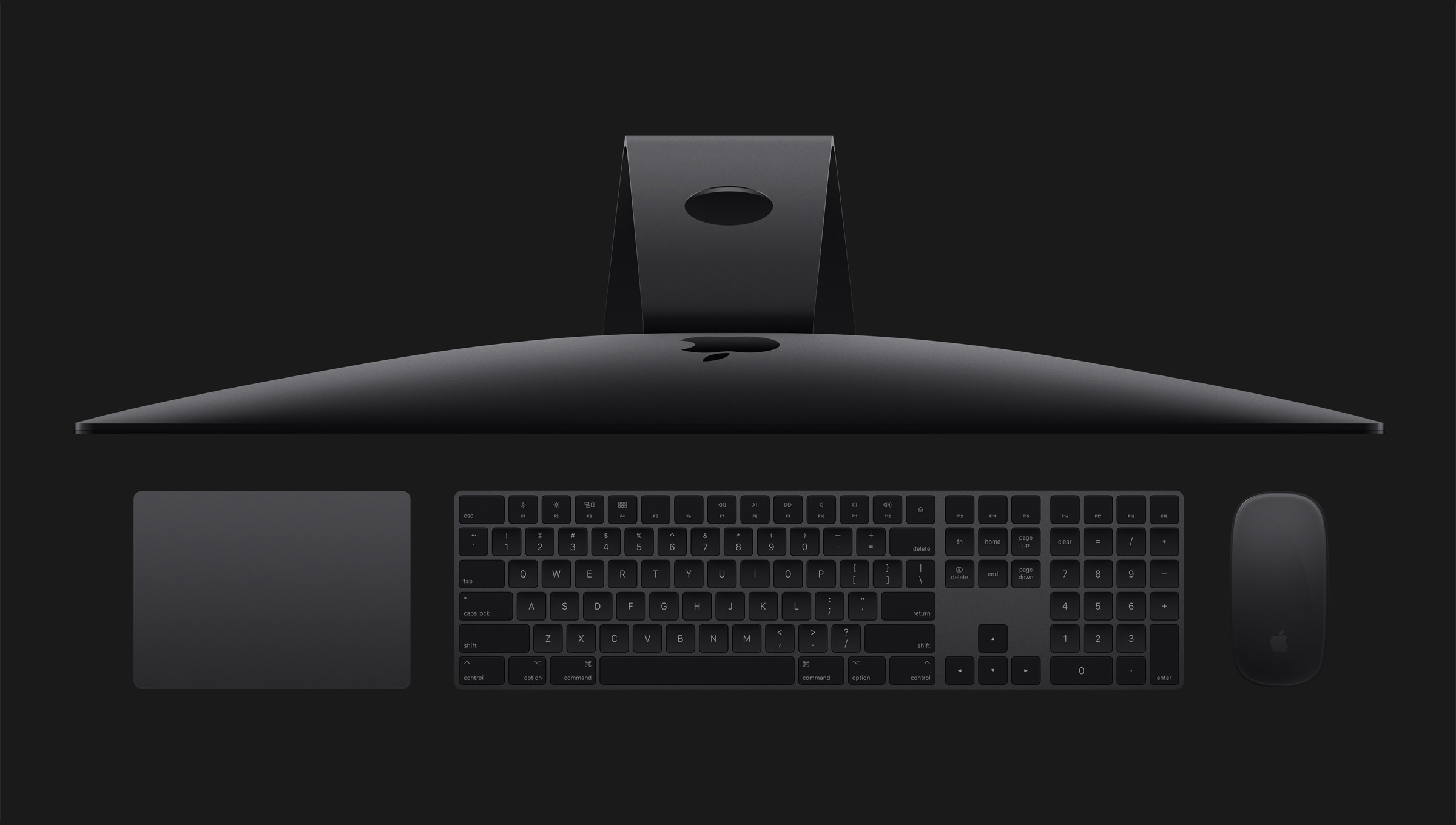 iMacs Pro de cima com teclado e mouse