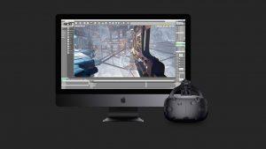 Dispositivo de realidade virtual HTC Vive plugado a um iMac