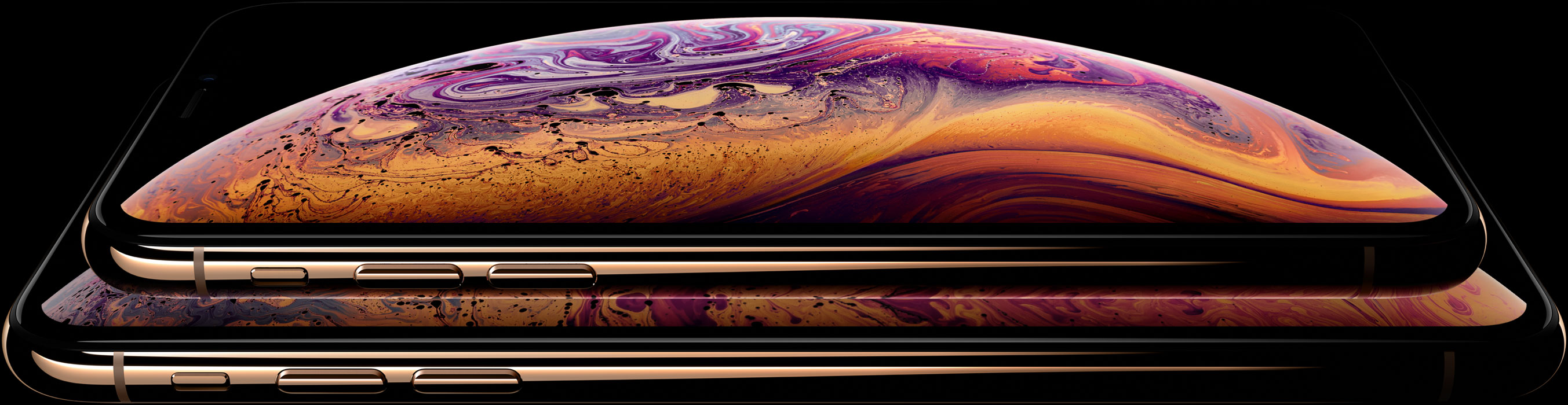 iPhone Xs e Xs Max dourado sobre fundo preto