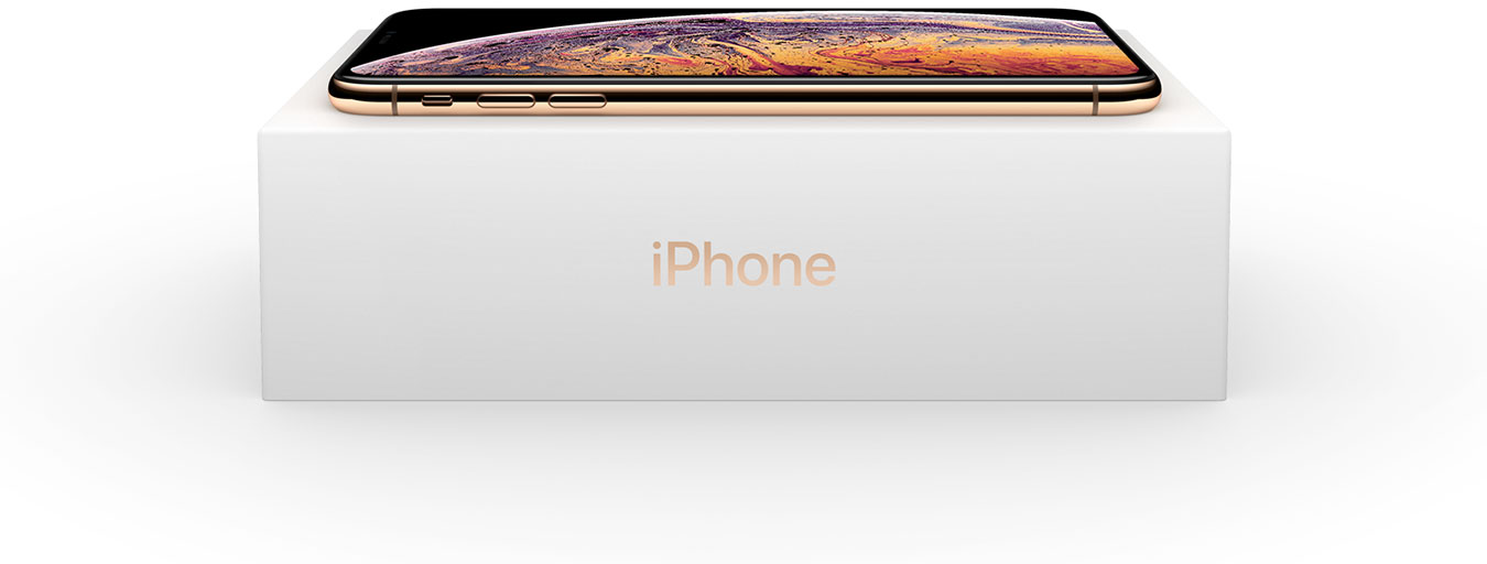 iPhone XS dourado sobre a sua caixa