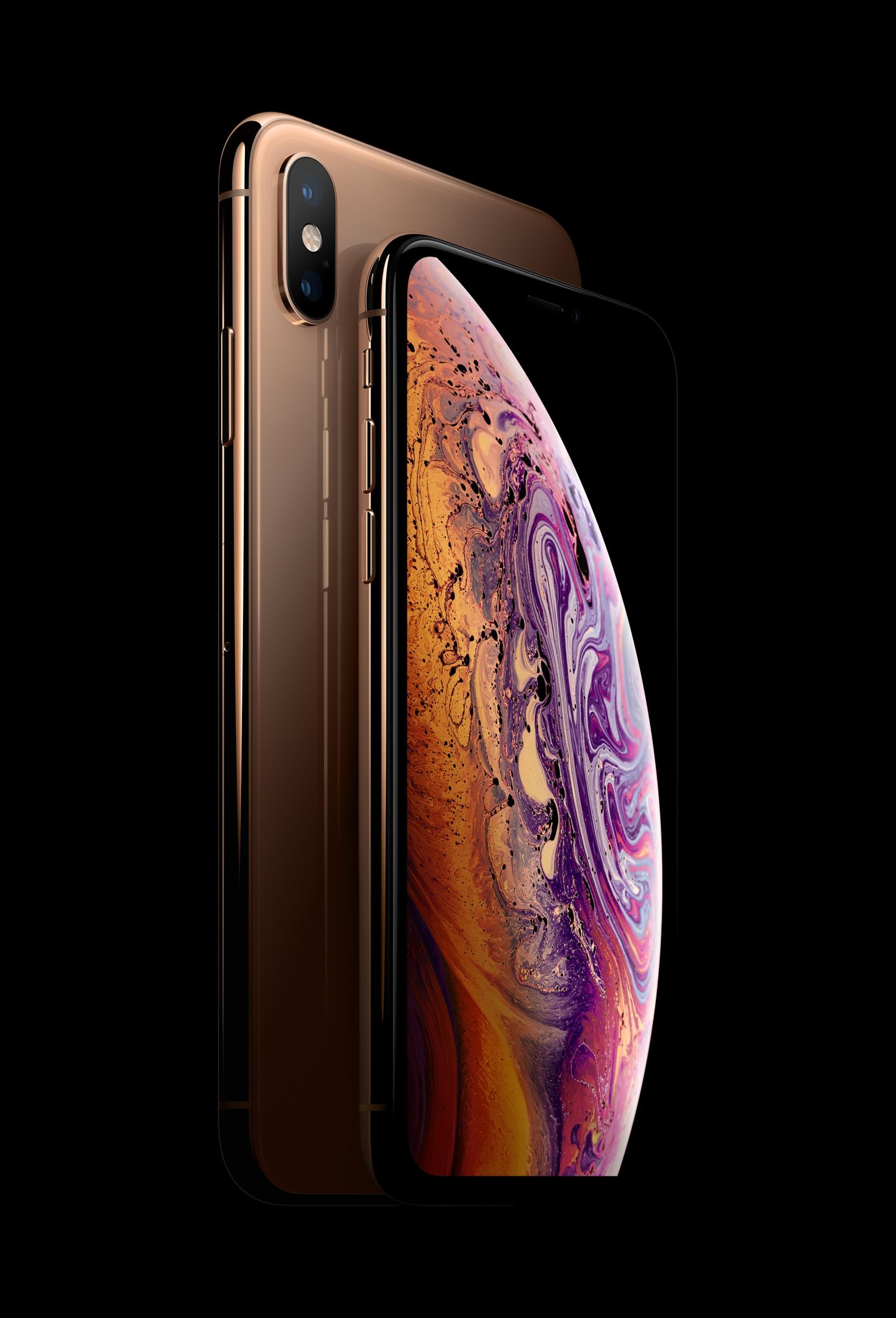iPhone Xs e Xs Max em dourado num fundo preto