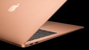 Novo MacBook Air dourado de lado com suas portas Thunderbolt 3