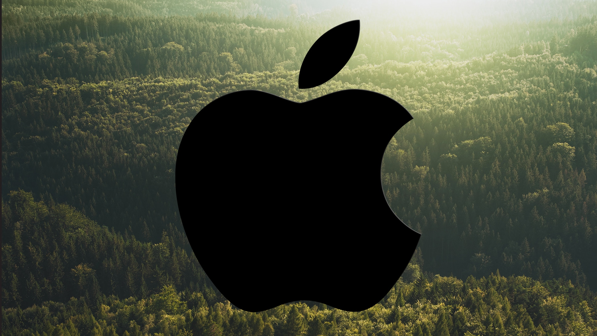 Logo da Apple sobre uma floresta