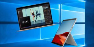 Mac e Surface Pro X na frente do logo do Windows