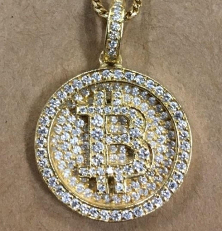 Bitcoin encrustada em diamantes